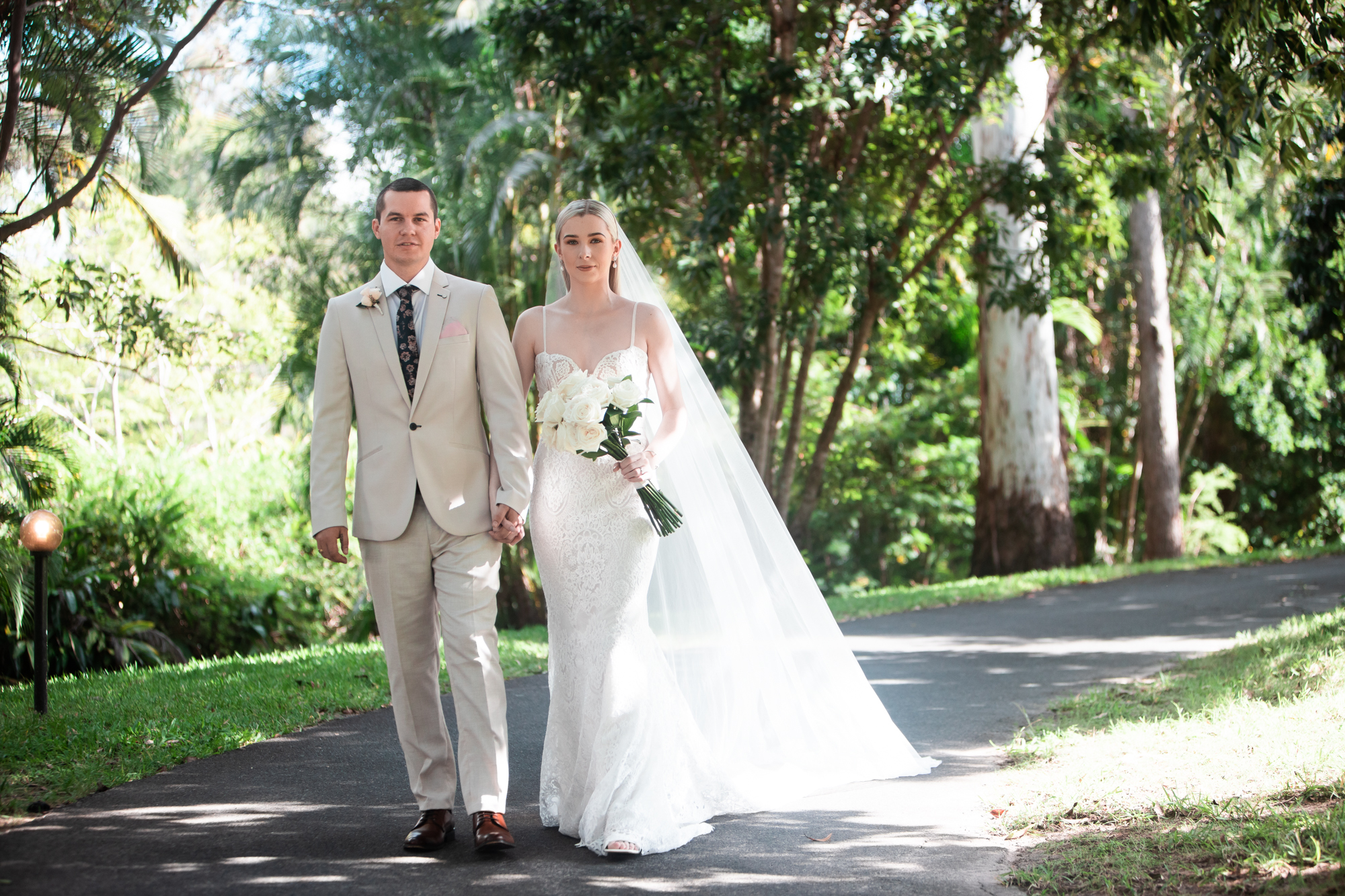 Bride and Groom take a stroll at Coolibah Downs Estate