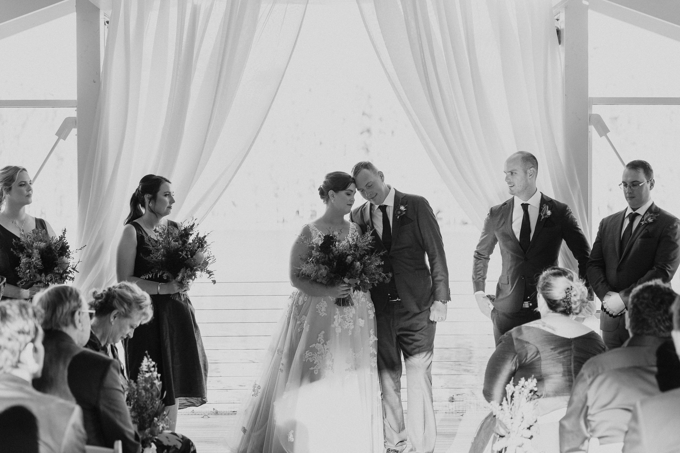 Amy & Alex sharing an intimate moment during their ceremony