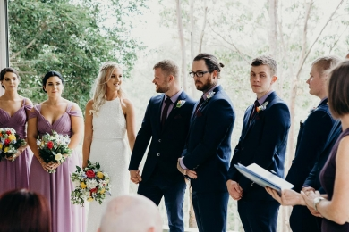 Wedding Celebrant Lorraine Wright standing beside bride and groom and their bridal party while officiating a wedding at Clear Mountain Lodge
