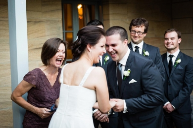 Wedding Celebrant Lorraine Wright bending forward laughing out loud with bride and groom after they said funny wedding vows