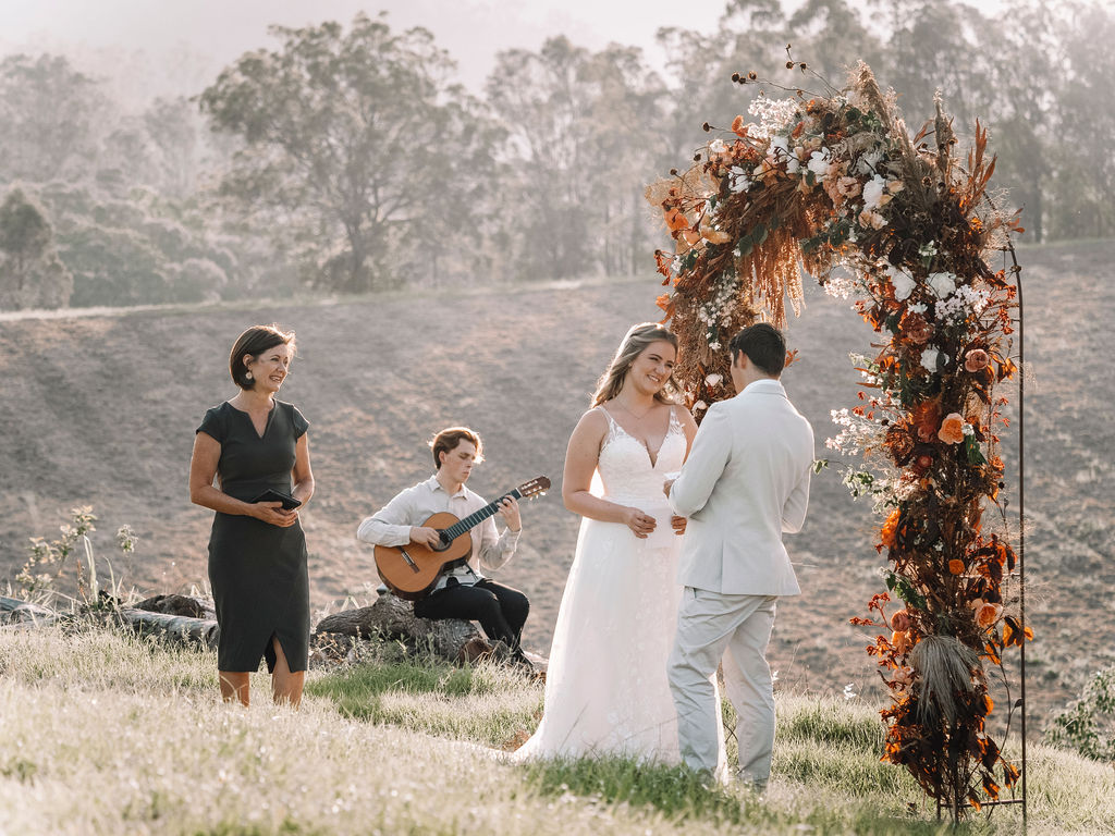 Bridal Couple Exchange Vows while Celebrant and Guitarist watch on