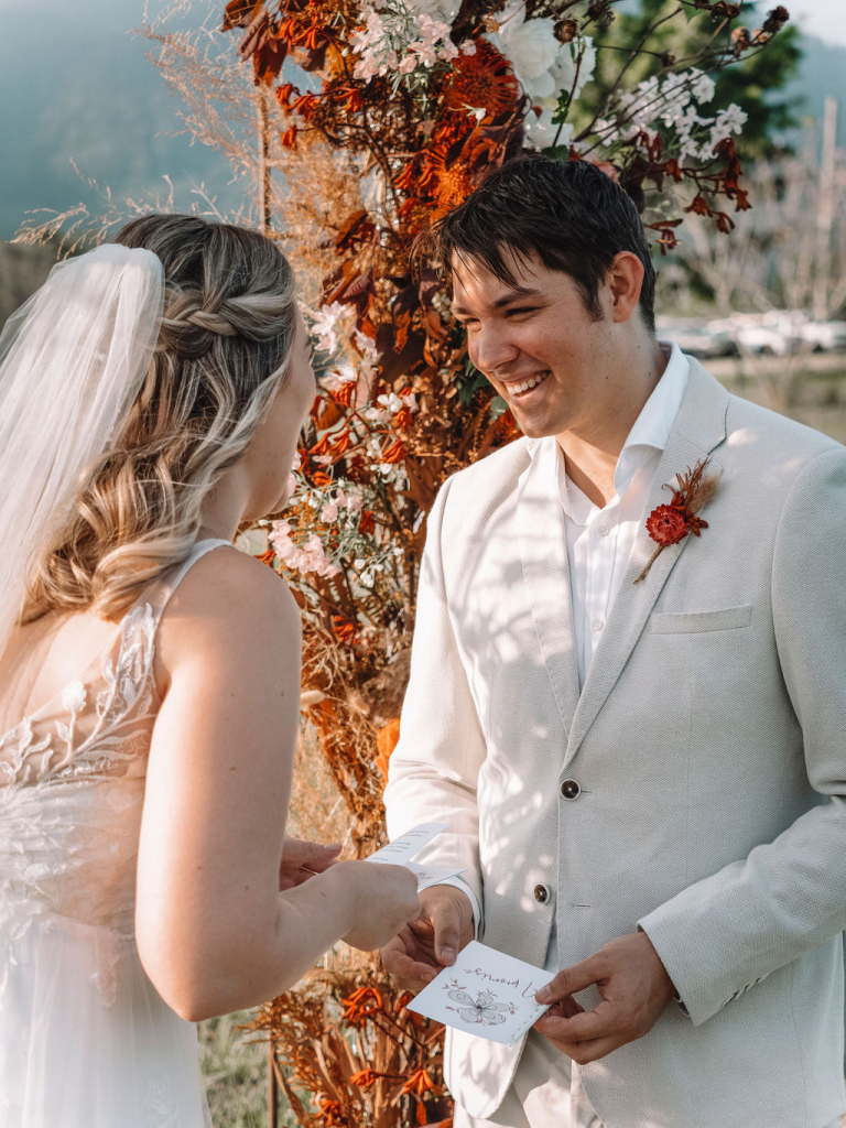 Couple laugh as they say their wedding vows