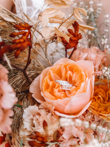 Wedding Rings Sitting in Apricot-Coloured Flower